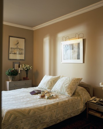 mediterranean interior: View of a cozy bedroom LANG_EVOIMAGES