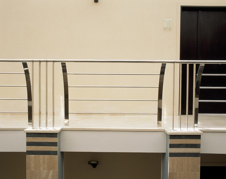 mediterranian style: Partial view of a metallic railing