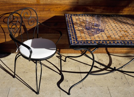 mediterranian home: View of a chair and a dining table