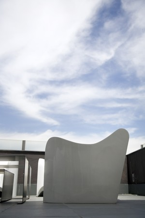 no cloud: Armchair with a table on a terrace