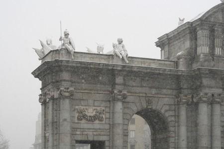 Snowfall over a monument, Puerta De Alcala, Madrid, Spain photo