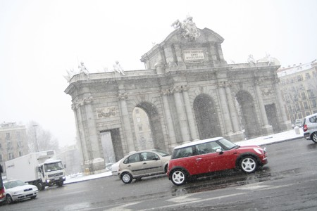 Traffic in rain at a monument, Puerta De Alcala, Madrid, Spain photo