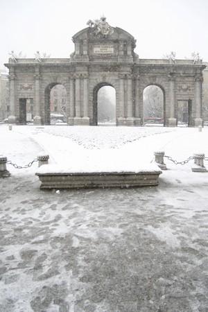 singular architecture: Facade of a monument, Puerta De Alcala, Madrid, Spain
