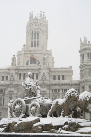 singular architecture: Statue in front of a building, Statue Of Cybele, Palacio De Comunicaciones, Madrid, Spain Stock Photo