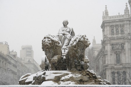 singular architecture: Statue in front of a building, Statue Of Cybele, Palacio De Comunicaciones, Madrid, Spain Stock Photo