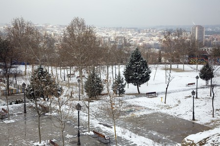 Snow covered park with buildings in the background, Madrid, Spain Stock Photo - 7353914