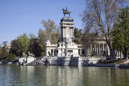 singular architecture: Monument at the lakeside, Alfonso XII Monument, Parque Del Retiro, Monumento A Alfonso XII, Retiro Park, Madrid, Spain Stock Photo