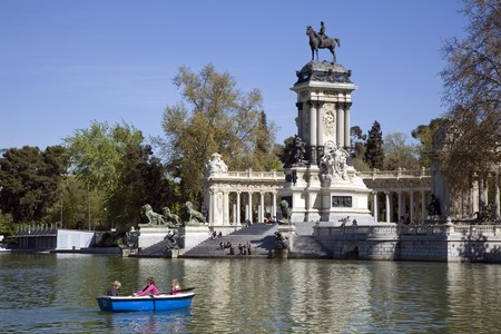 Tourists boating in a lake, Alfonso XII Monument, Parque Del Retiro, Monumento A Alfonso XII, Retiro Park, Madrid, Spain