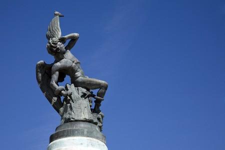fallen angel: Low angle view of a statue, Statue Of The Fallen Angel, Fountain, Fuente Del Angel Caido, Parque Del Retiro, Retiro Park, Madrid, Spain