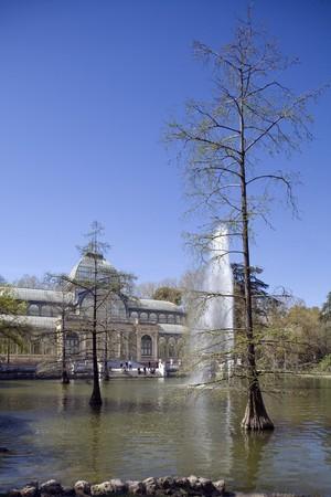 singular architecture: Fountain in a pond in front of a palace, Palacio De Cristal, Parque Del Retiro, Retiro Park, Madrid, Spain