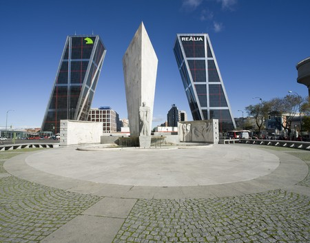 architectural feature: Monument in front of two skyscrapers, Calvo Sotelo Monument, Puerta De Europa, Plaza De Castilla, Madrid, Spain