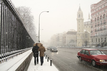Couple walking at the roadside, Madrid, Spain photo