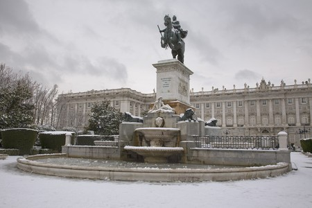 Equestrian statue in front of a palace, Palacio Real, Royal Palace, Plaza De Oriente, Madrid, Spain photo