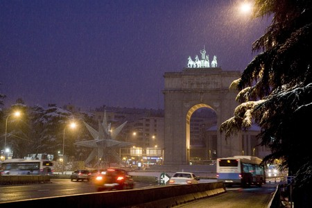 Traffic on the road, Arco De La Victoria, Madrid, Spain photo