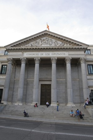 singular architecture: Tourists in front of a parliament building, Congreso De Los Diputados, Madrid, Spain