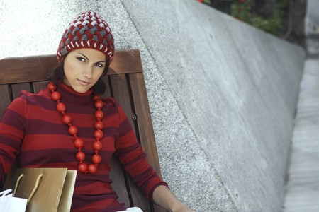 designer labels: Young woman model dressed in red and white possing for a picture. Stock Photo