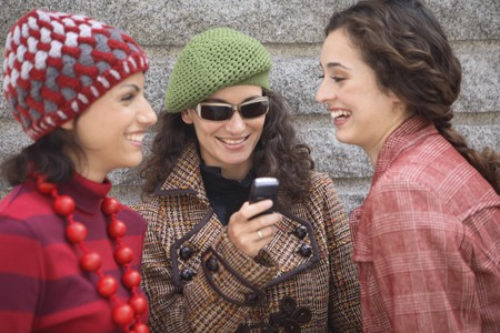 designer labels: Three young women models talking and smiling