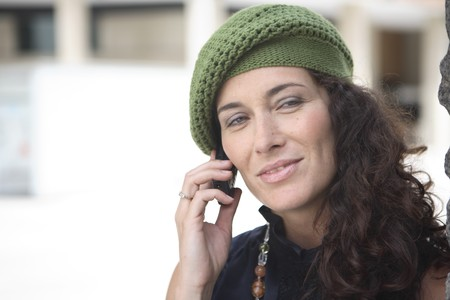 Young latin woman talking on the mobile phone. Stock Photo - 7475698