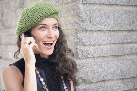 Happy and smiling young latin woman talking on the mobile phone. Stock Photo