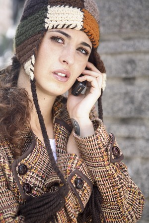 Yng latin woman talking on the mobile phone. photo