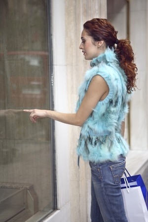 designer labels: Young woman window shopping in Madrid, Spain Stock Photo