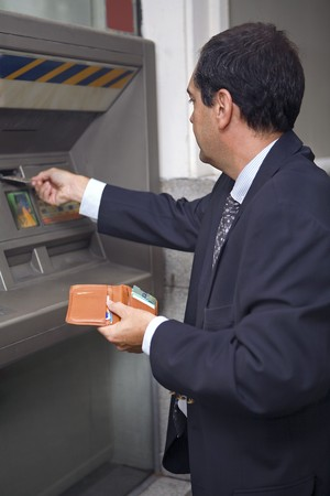cashpoint: Man at ATM