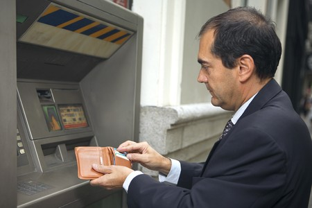 automatic teller machine: Man at ATM