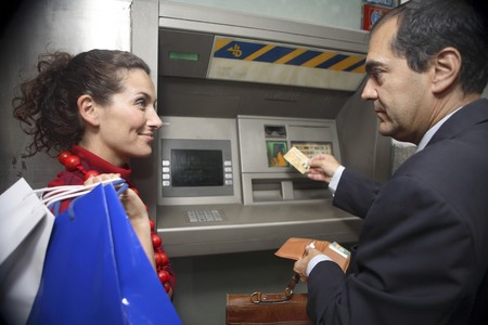 attractiveness: Couple at ATM
