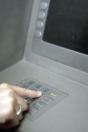 cashpoint: Detail of masculine hand at ATM