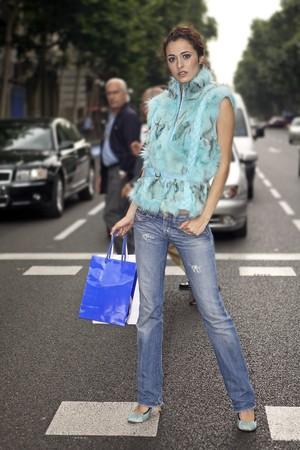 designer bag: Youn latin woman possing in Serrano Street, Madrid, Spain Stock Photo