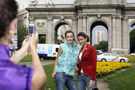 One young latin woman taking picture of her friends at Madrid, Spain Stock Photo - 7475825