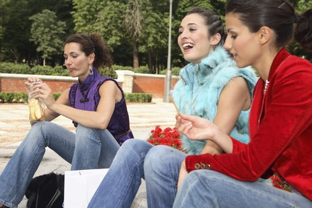 Three young latin women resting and talking. Stock Photo - 7475792
