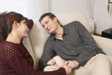 Young couple talking on a sofa. Stock Photo - 7475933