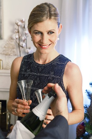 fireplaces: One elegant adult woman about to drink a glass of champaign