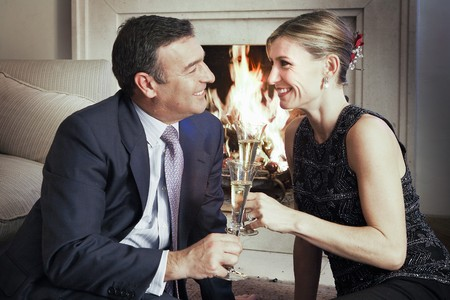 fireplaces: Couple toasting with Champaign Stock Photo