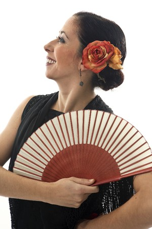 seville: Typical spanish gypsy with carnation and fan