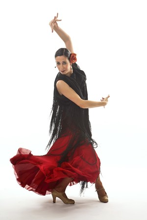Typical spanish gypsy with carnation and fan, dancing Sevillanas.