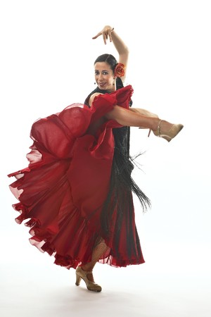 typical: Typical spanish gypsy with carnation and fan dancing Sevillanas. Stock Photo