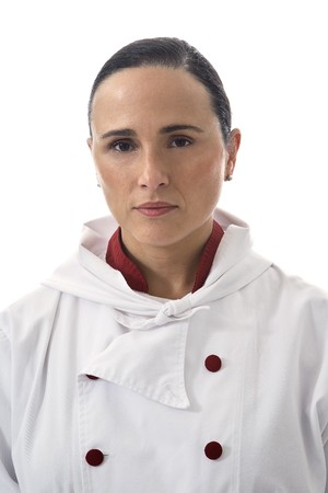 Latin Looking Woman cook dressed in white. photo