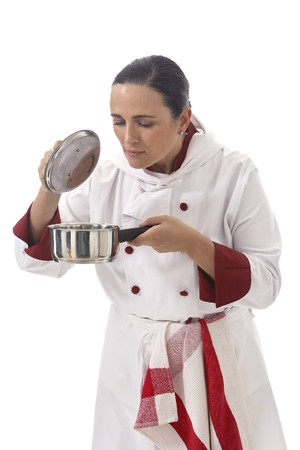 Latin Looking Woman cook dressed in white testing the food. Stock Photo - 7475659