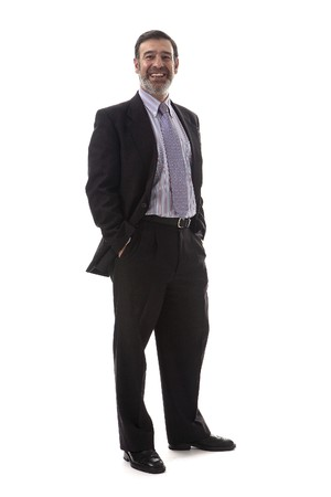 mobilephones: Latin looking Business executive talking on his mobile phone. Stock Photo