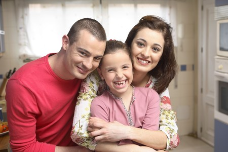 Young couple with 7-9 years old daughter.