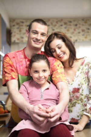 Young couple with 7-9 years old daughter. Stock Photo - 7475697