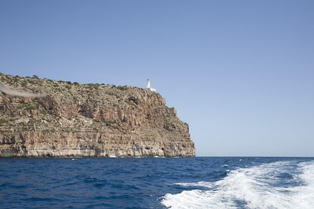 Lighthouse La Mola,from the sea, Formentera, Balearic Islands, Spain photo