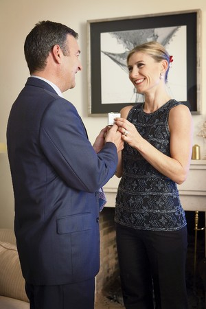 Husband giving a present to his wife. photo
