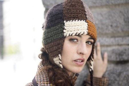 designer labels: Young woman latin model looking at camera.