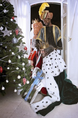 Magic Kings placing Christmas presents by the tree. Stock Photo - 7483197