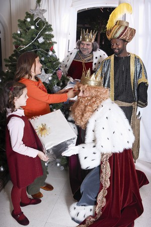 Magic Kings placing Christmas presents by the tree. Stock Photo - 7483199