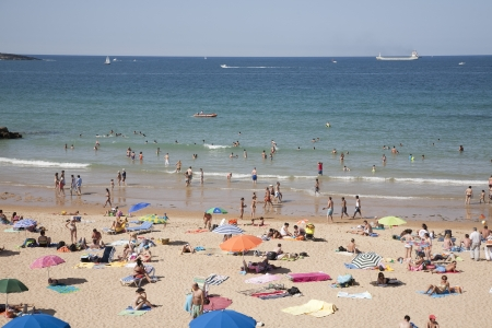 crowded space: Beaches of Santander, Santader, Spain Editorial