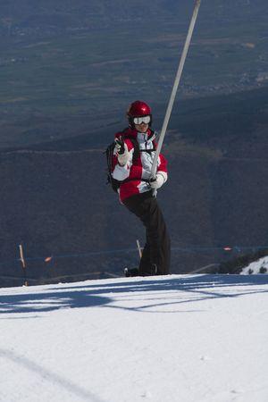 Young boy at t-bar ski lift at ski resort, La Masella, Girona. Stock Photo - 7824718